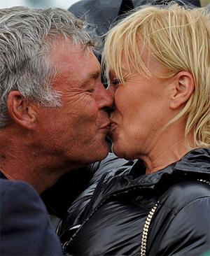 A delighted Darren Clarke kisses his partner Alison after winning the British Open golf championship. Photo: Reuters