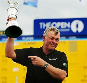 Darren Clarke holds aloft the Claret Jug. Photo: PA
