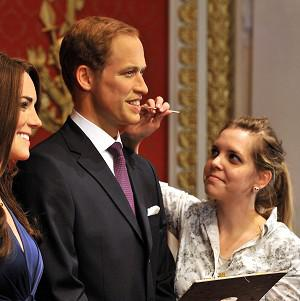Rebecca Holmes gives William and Kate a final touch-up before the unveiling