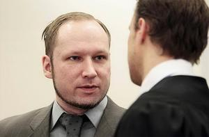 Anders Behring Breivik in conversation with member of his defence team Tord Jordet in the courtroom in Oslo on April 25. Photo: AP