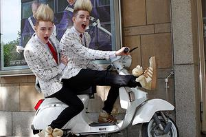 Jedward pose on a motorbike in Dusseldorf , the host city for Eurovision