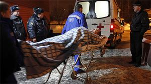 A wounded blast victim  is wheeled into an ambulance near Domodedovo airport in Moscow. Photo: AP