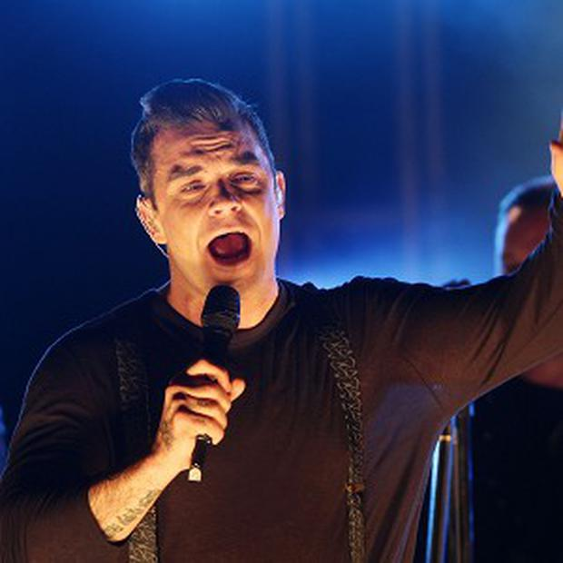 Robbie Williams admitted he would like to be hailed as a national treasure