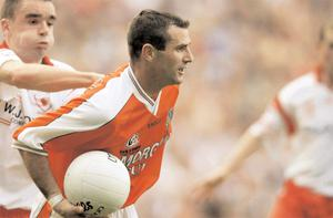 Armagh's Steven McDonnell tries to get away from Tyrone's Ryan McMenamin during the 2003 All-Ireland final when the rivalry between the counties was at its highest