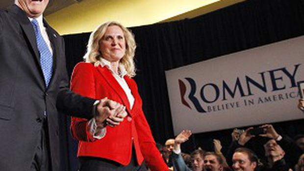 A county chairwoman had to be woken in the middle of the night before the final votes that secured Mitt Romney's win in the Iowa caucus came in (AP)