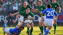Keith Earls bursts his way past the tackle of Italy's Kris Burton on Saturday.