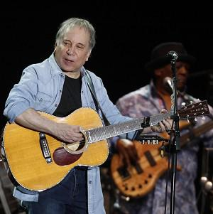 Paul Simon performs during a concert at the Arena Civica in Milan, Italy, with Bobby McFerrin (AP/Luca Bruno)