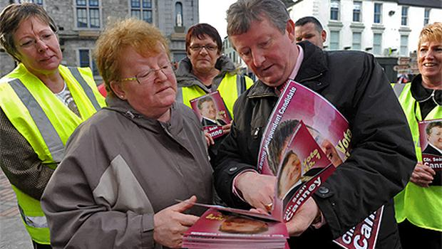 Independent candidate Sean Canney explaining his policies to local resident Margaret Higgins in Tuam