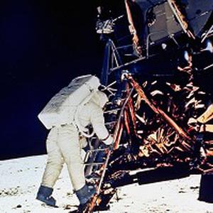 Buzz Aldrin descends the steps of Lunar Module ladder as he prepares to walk on the moon (AP)