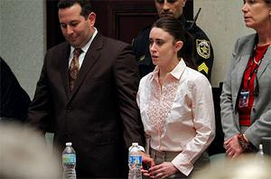 Casey Anthony, centre, reacts to being found not guilty of murdering her daughter Caylee (2). Photo: Reuters
