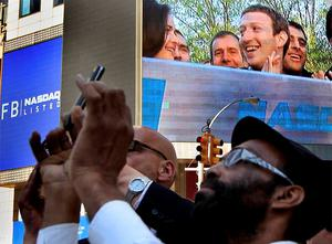 Facebook Inc. CEO Mark Zuckerberg is seen on a screen televised from their headquarters in Menlo Park moments after their IPO launch in New York  on May 18. Photo: Reuters
