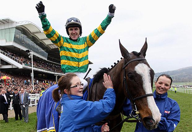 Tony McCoy celebrates ridding Synchronised to victory in the Betfred Cheltenham Gold Cup