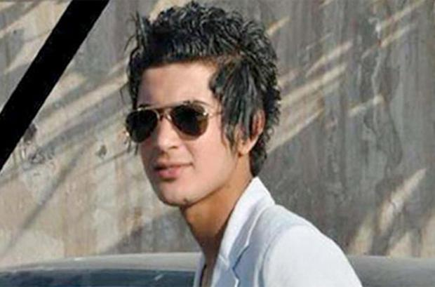 Iraqi activists said this picture belongs to a teenager who was brutally killed by religious police for having an 'emo' hairstyle