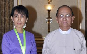 Burmese opposition leader Aung San Suu Kyi poses for a photograph with Burma President Thein Sein during their meeting at the president's office in Naypyitaw.
