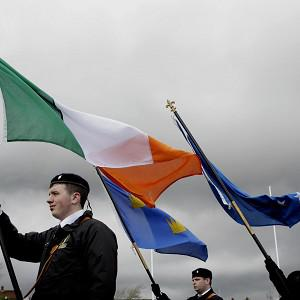 A colour party from the 32 county sovereignty movement parades to Creggan Cemetery (AP)