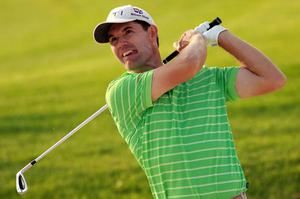 Padraig Harrington plays his second shot on the 17th hole during the first round of the Volvo Golf Champions tournament in Bahrain yesterday. Photo: Getty Images