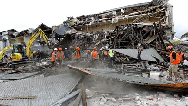 Rescue workers search for survivors through debris in Christchurch, New Zealand. Photo: Getty Images
