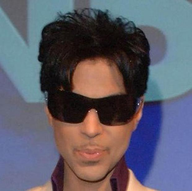 A Irish concert promoter has settled a court case with Prince