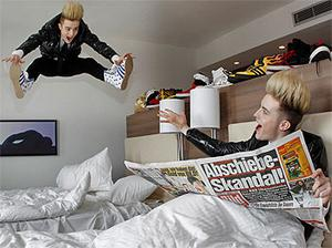 The pair muck about in their Dusseldorf hotel room