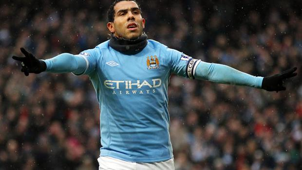 Carlos Tevez celebrates after scoring the third goal of his hat-trick against West Brom last week and he will lead the line again for Manchester City this afternoon. Photo: Getty Images