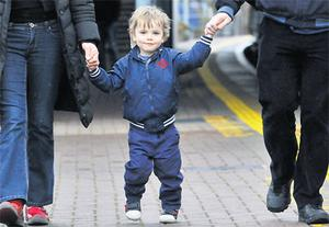 Three-year-old Calum Geary with his parents Andrew and Helen.