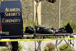 A body rests outside a coroner's van outside Oikos University in Oakland, Calif.  A gunman opened fire at the university, killing at least five people. Photo: AP