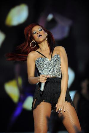 US singer Rihanna performs at an NBA All-Star basketball game on February 20, 2011 part of NBA All-Star Weekend at Staples Center in Los Angeles, California. AFP PHOTO / POOL / Lucy Nicholson (Photo credit should read LUCY NICHOLSON/AFP/Getty Images)