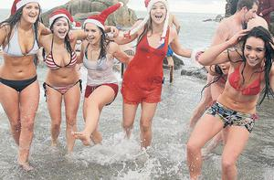 CHRISTMAS swimmers didn't have to 'brave' the elements yesterday. It was one of the warmest Christmas Days on record with temperatures higher than in Greece. Enjoying their festive plunge at the famous Forty Foot bathing spot at Sandycove, Dublin were Anna Fayne, Meadbh Collison, Phoebe Collison, Kate Morrisey, Emily Collison and Rosa Fayner.