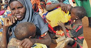 Somalian refugees, above, in the registration area of the refugee camp at Dadaab, Kenya, yesterday