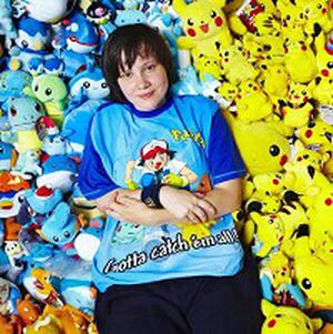 Lisa Courtney, 21, poses with her record breaking collection of Pokemon memorabilia