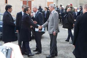 French President Nicolas Sarkozy shakes hand with Toulouse prosecutor Michel Valetas  as he arrives to monitor police operations.