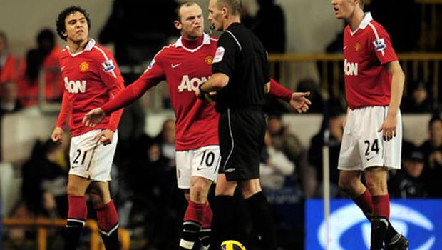Wayne Rooney and Rafael Da Silva (L) protests as referee Mike Dean shows the Brazilian defender a red card on Sunday. Photo: Getty Images