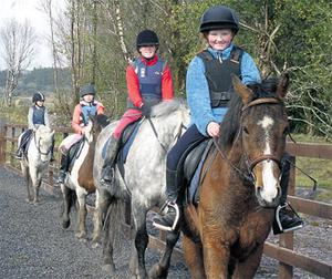 Pupils are given their first riding lesson