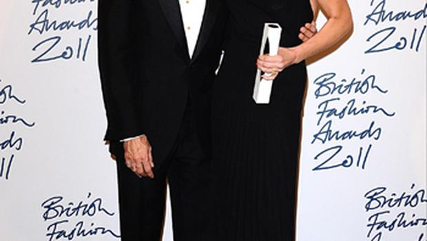 Victoria Beckham with the Designer Brand award and Marc Jacobs at the 2011 British Fashion Awards at the Savoy, London. Photo: PA