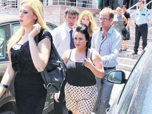Shannon Graham (centre) and supporters leave court in Izmir, Turkey, yesterday