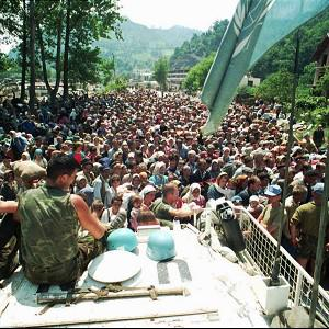 Refugees from Srebrenica gather around a Dutch armoured vehicle before the 1995 Srebrenica massacre(AP)