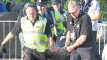 A man being taken away during the concert on Saturday.