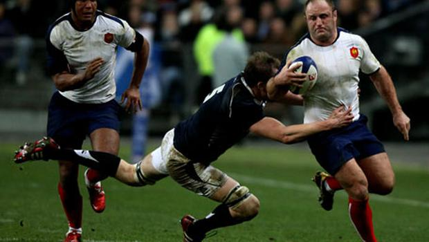 France hooker Wiliam Servat is tackled by Scotland's Alastair Kellock during their Six Natins clash last weekend. Photo: Getty Images