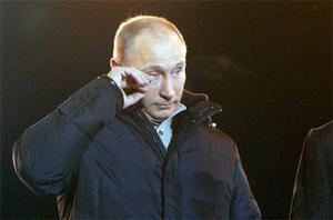Vladimir Putin wipes away tears at a victory rally in Moscow. Photo: Reuters