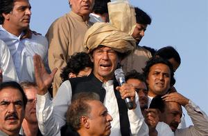 Pakistan's ex-cricket star-turned-politician Imran Khan, center, addresses his supporters during a peace march in Tank, Pakistan
