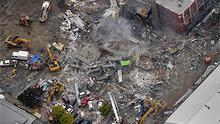 An aerial view of the flattened Canterbury Television building in central in Christchurch where up to 100 people are believed to have died. Photo: AP