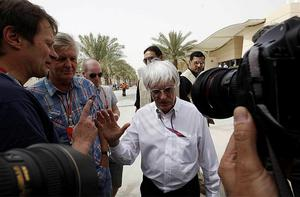 Bernie Ecclestone, president and CEO of Formula One Management is surrounded by reporters during the second free practice ahead of the Bahrain Formula One Grand Prix. Photo: AP