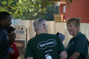 Noel Meehan (Team leader)  Director of Specsavers in Galway, Ireland  talks with Karen Edwards, Programme Director  Vision Aid Overseas in Zambia