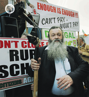 Leo Duggan from Co. Limerick protested outside Leinster House with Rural Ireland Against Charges.