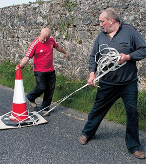 Local men Mike Hogan and Joe Burke create a makeshift trap to catch the young otter