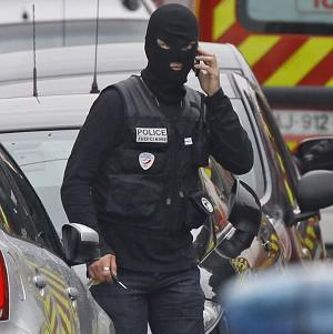 A police officer works at the scene of the stand-off in Toulouse (AP)