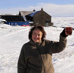 Landlady Tracy Daly in front of Britain's highest pub, The Tan Hill Inn