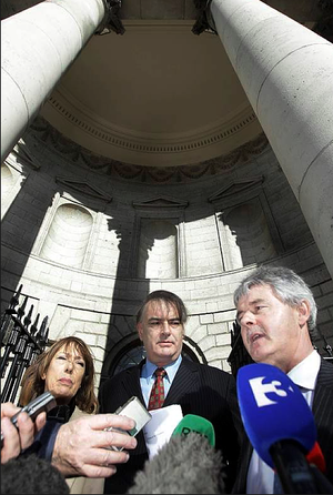 Ian Bailey (centre) and his partner Jules Thomas and solicitor Frank Buttimer (right) speak to the media outside the Supreme Court in Dublin after he won his challenge against his extradition to France. Photo: PA