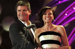 Simon Cowell and Danni Minogue. Photo: PA