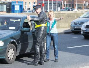 An irate woman remonstrates with a garda after being ordered to drive on